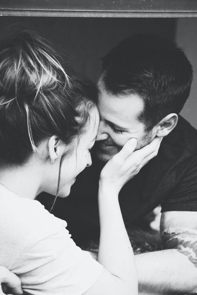 black & white image of couple snuggling
